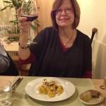 Julie happy at dinner